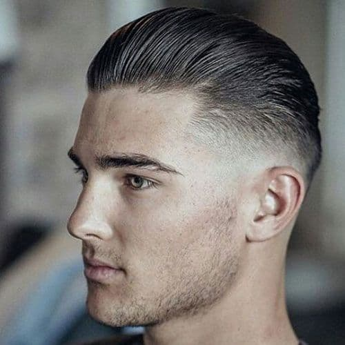 Low Skin Fade + Slicked Back Hairstyle